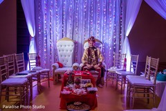 Elegant raja wearing the sherwani and pagri under the decor