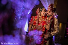 Indian bride and groom tender moment after the ceremony