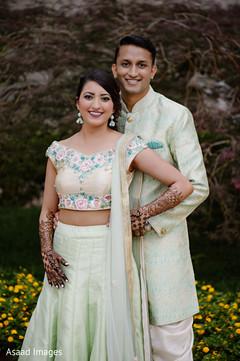 Beautiful maharani and elegant raja pose for pictures