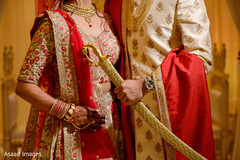 Details of the sari and the sherwani worn by the Indian couple