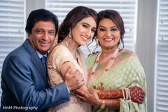 Lovely bride with parents portrait.