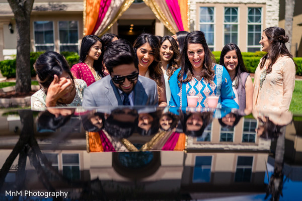 Indian groomsmen and bridesmaids welcoming the groom.