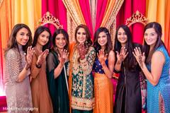 Maharani and bridesmaids showing their mehndi art.