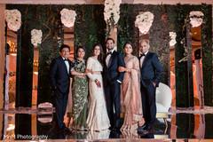 Elegant Indian bride and groom's with parents capture.