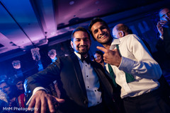 Upbeat Indian guest and groom capture.