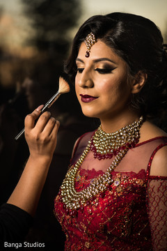 Maharani being assisted with hair and makeup