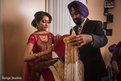 Awesome capture of Indian groom being assisted with the pagri