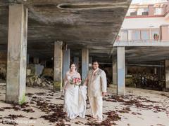 Elegant Indian bride and groom outdoors capture.