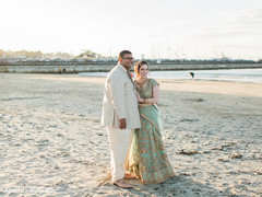 Indian lovebirds by the beach photo session.
