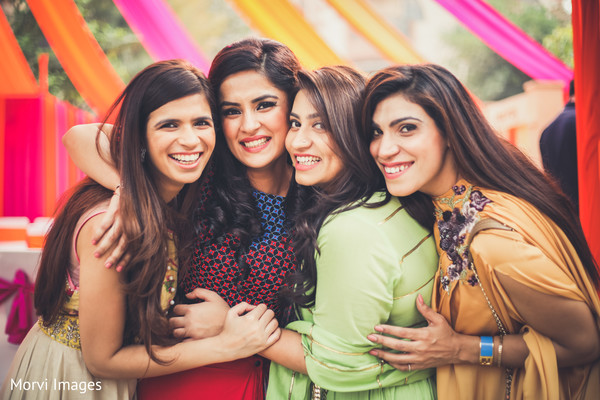 Gorgeous Indian bride with bridesmaids at sangeet party.