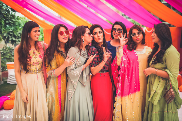Beautiful indian bride with bridesmaids sangeet photo.