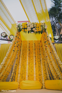 Stunning Indian mehndi party flowers decoration.