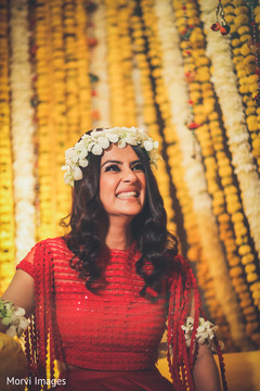 Joyful Indian bridal mehndi party.