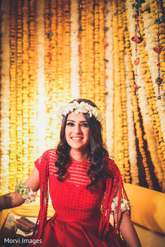 Radiant Indian bride at her mehndi party.