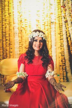 Elegant Indian bride with her mehndi art done.