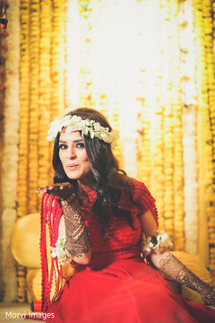 Enchanting indian bride during mehndi celebration.
