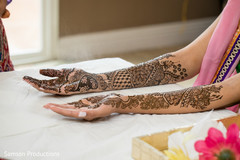 Indian bride waiting for the henna to dry