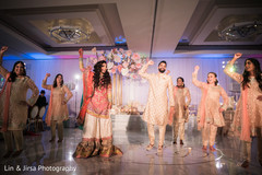 Indian newlyweds and guests performing a choreography