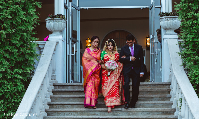 Maharani escorted by her family walks towards the ceremony
