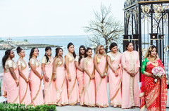 Amazing capture of bridesmaids on the seashore with maharani