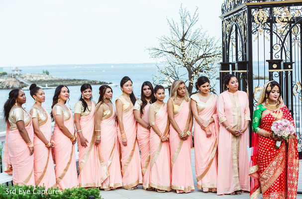 Amazing capture of bridesmaids on the seashore with maharani