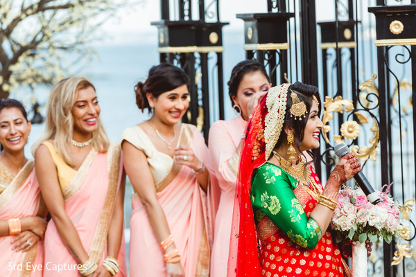 Maharani delivering some words while bridesmaids observe