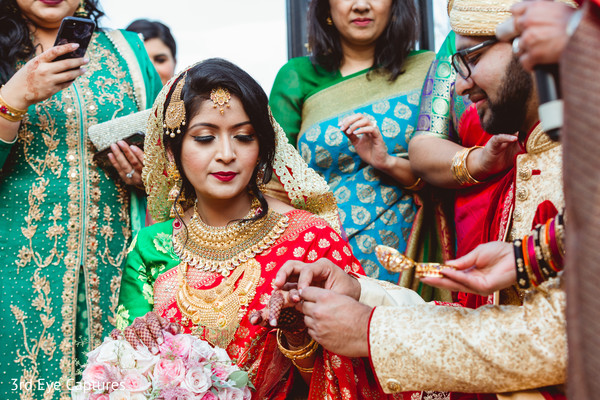 Raja putting the ring on the maharani's finger during the ceremony
