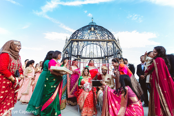 Indian bride and groom during the ceremony under the mandap
