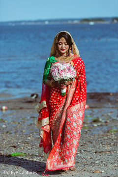 Ravishing Indian bride posing outdoors.
