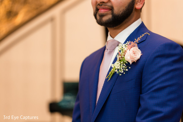 Raja wearing an elegant blue suit for the ceremonies