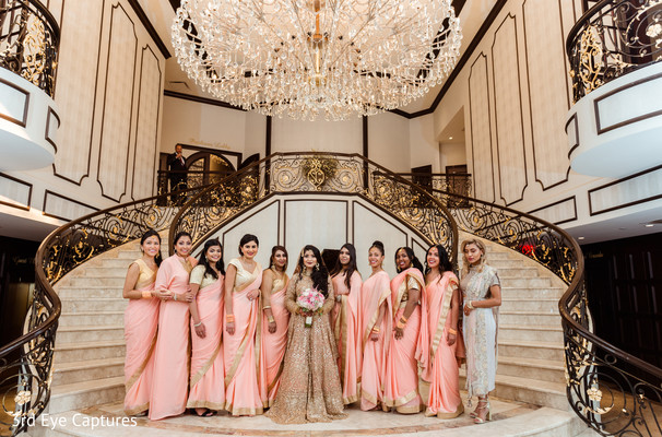 Indian bridesmaids pose with the beautiful maharani