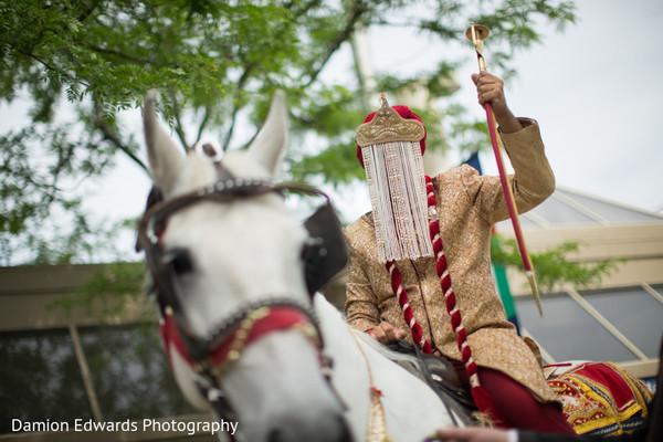 Raja riding the ghodi and holding the kirpan during baraat