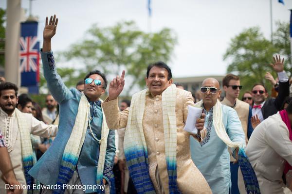 Family and groomsmen enjoying the fun baraat
