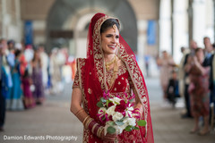 Beautiful Indian bride holding the bouquet prior to the ceremony
