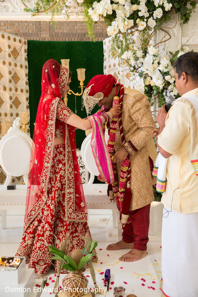 Maharani placing the flower garland on Raja during the ceremony