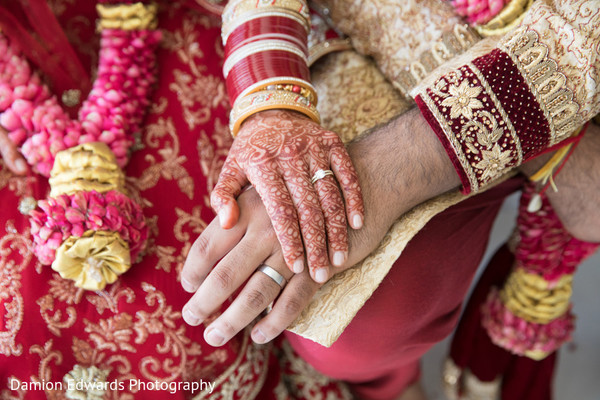 Beautiful mehndi and rings detail on the Indian newlyweds