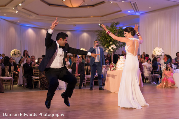 Indian newlyweds having a blast dancing during the reception