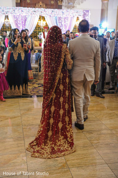 Enchanting Indian bride walking in to wedding ceremony