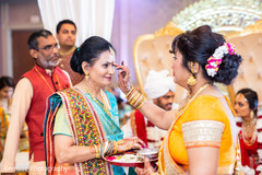See this Indian wedding ceremony ritual.
