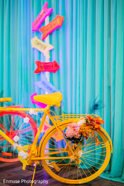 Indian pre-wedding bicycle flowers decor.