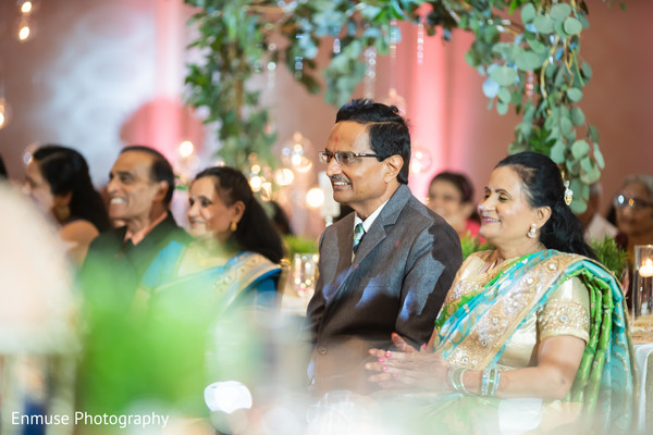 Joyful Indian wedding reception guest capture.