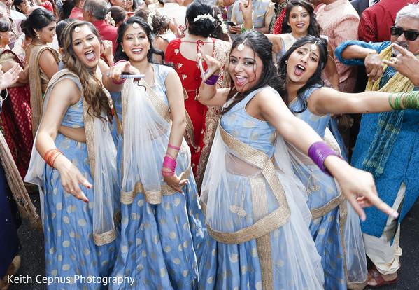 Beautiful bridesmaids during the baraat