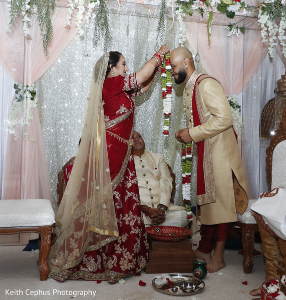 Indian bride and groom at their varmala ceremony