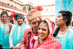 Tender moment between Indian bride and groom outdoors