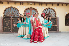 Fun capture of Indian couple with groomsmen and bridesmaids