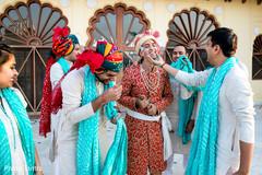 Fun moment between raja and groomsmen