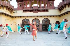 Raja and groomsmen performing a choreography