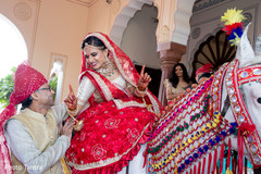 Joyful Indian bride arriving at the venue