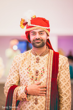 Charming Indian groom on his wedding ceremony outfit.