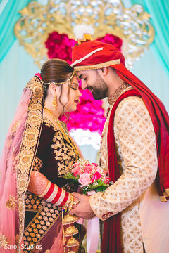 Indian bride and groom's romantic first look moment.